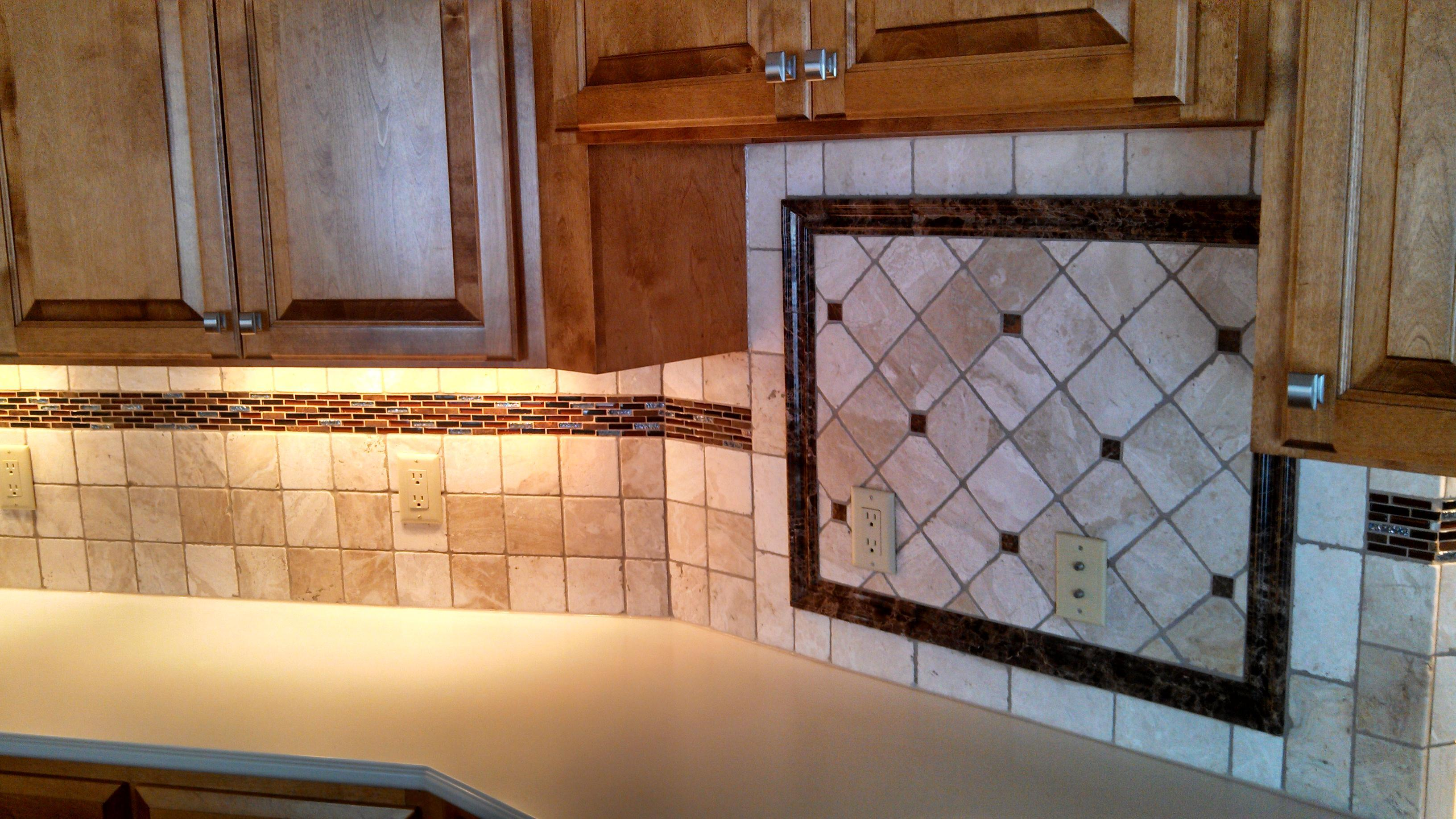 A unique design and installation to blend the backsplash pattern into a focal point over the desk area.