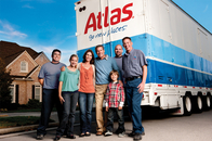 Atlas moving truck with a family and a professional van operator.