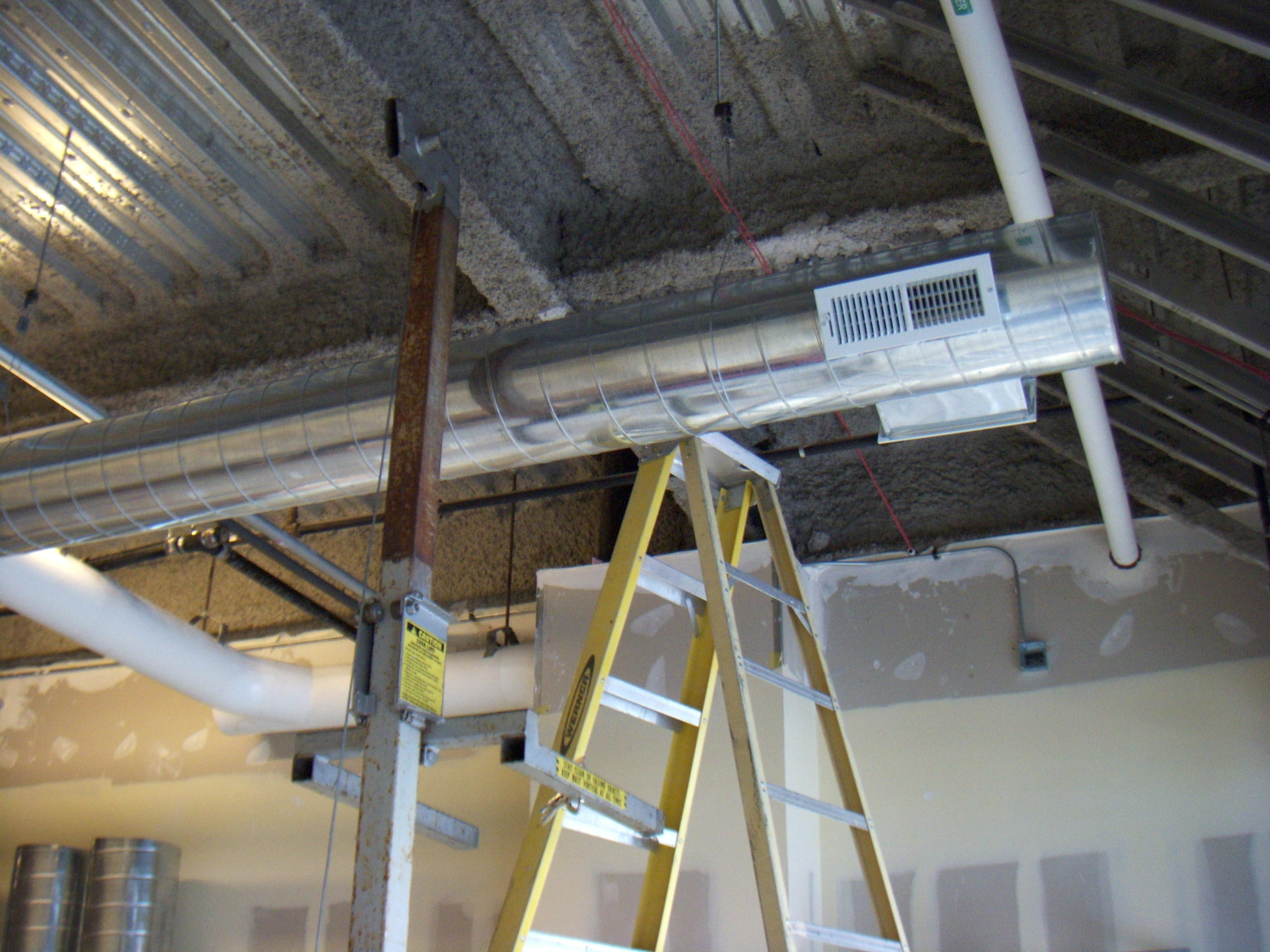 Installation of new spiral duct work in a retail commercial space