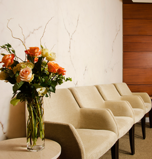 Our waiting room at Plastic Surgery & Dermatology of NYC, PLLC, offers a warm, welcoming vibe. We offer refreshments and reading material during your wait to ensure comfort and relaxation.