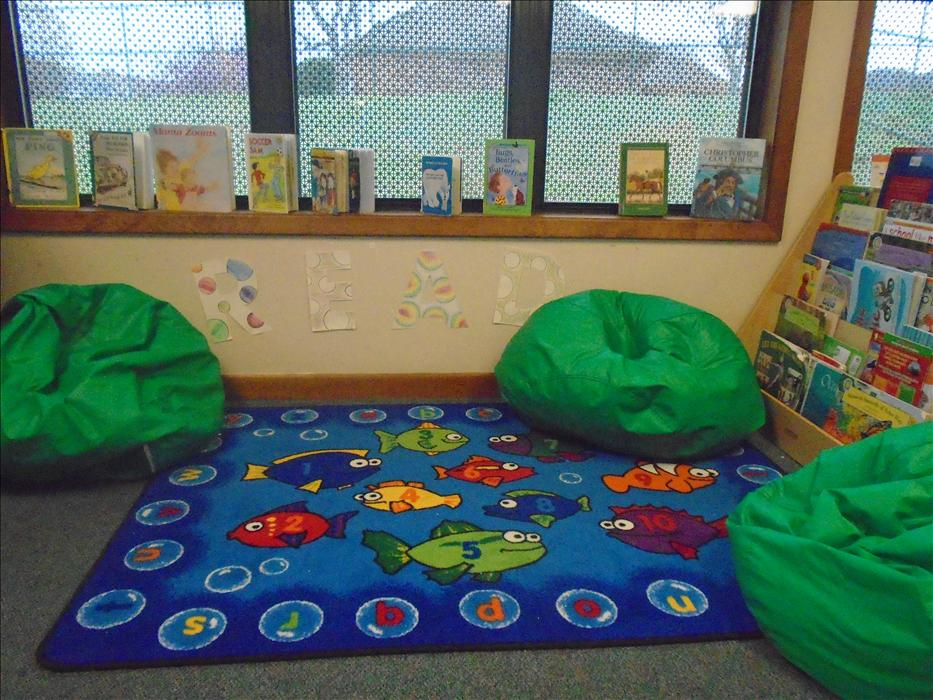 This is the reading area in the schoolage classroom.  Children enjoy charting their reading.