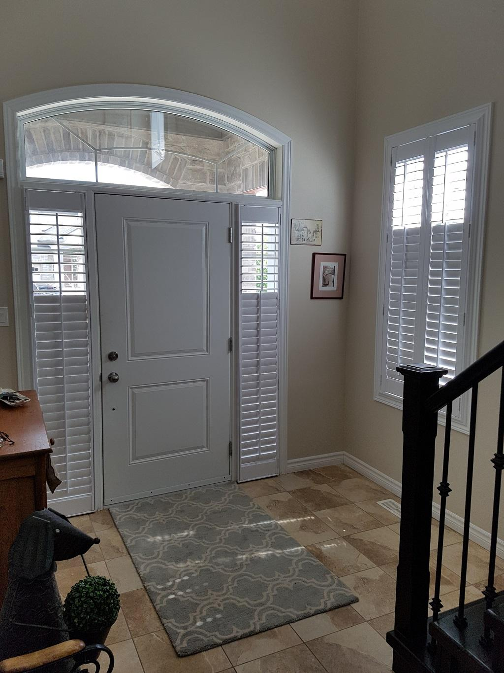 Budget Blinds à Waterloo: Adding shutters to your sidelights for light control is  a great solution. You can expect vinyl shutters to stand up well over time in a high-traffic area such as this.
