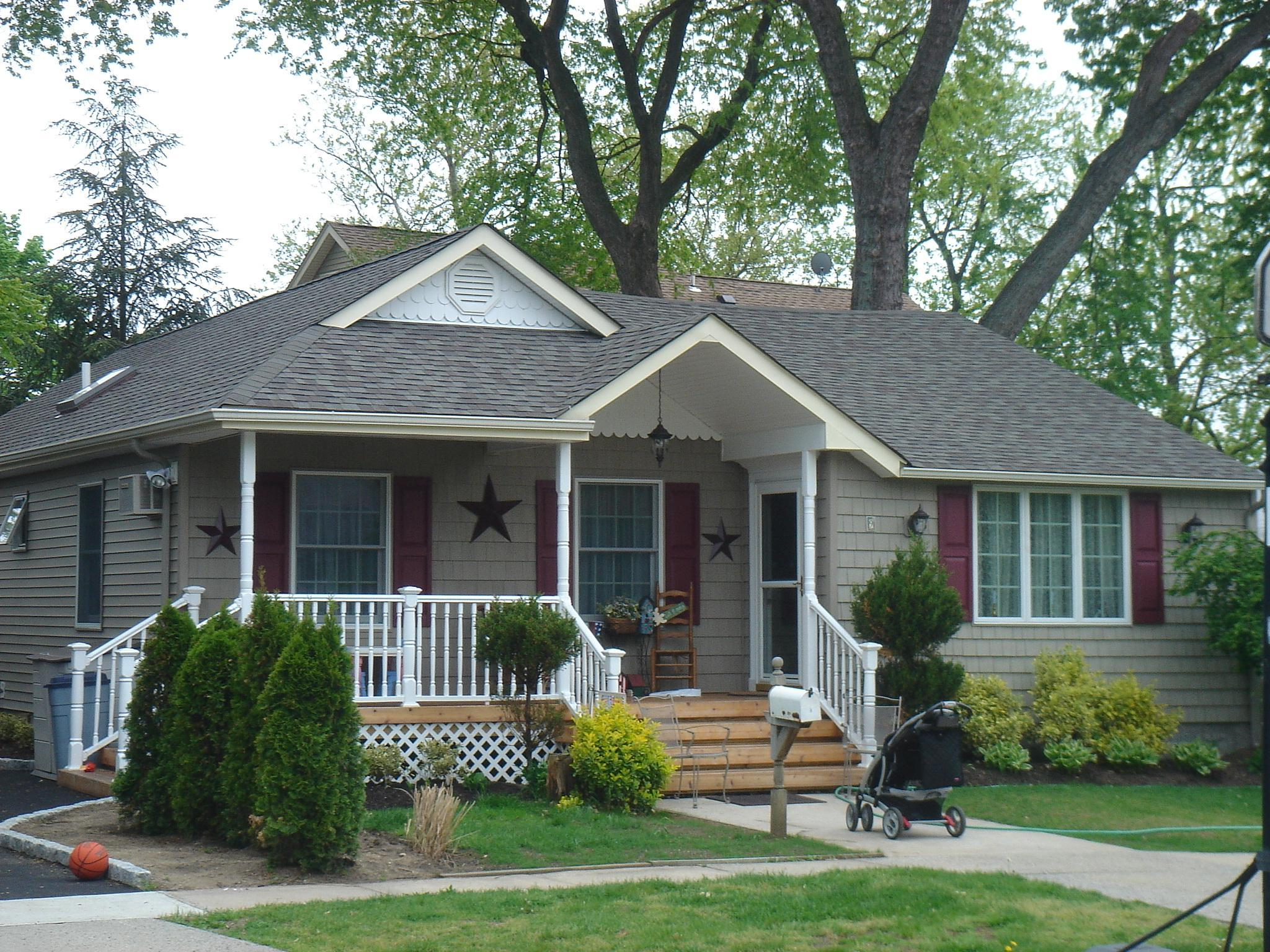 With a new porch and new roof lines and some charm took a small bungalow and gave it welcoming features.