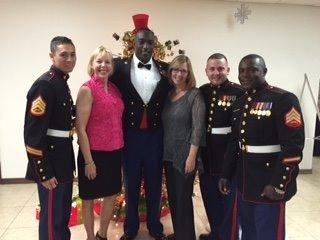 The Doctors stand with Marines on hand at a Toys for Tots fundraiser last year.