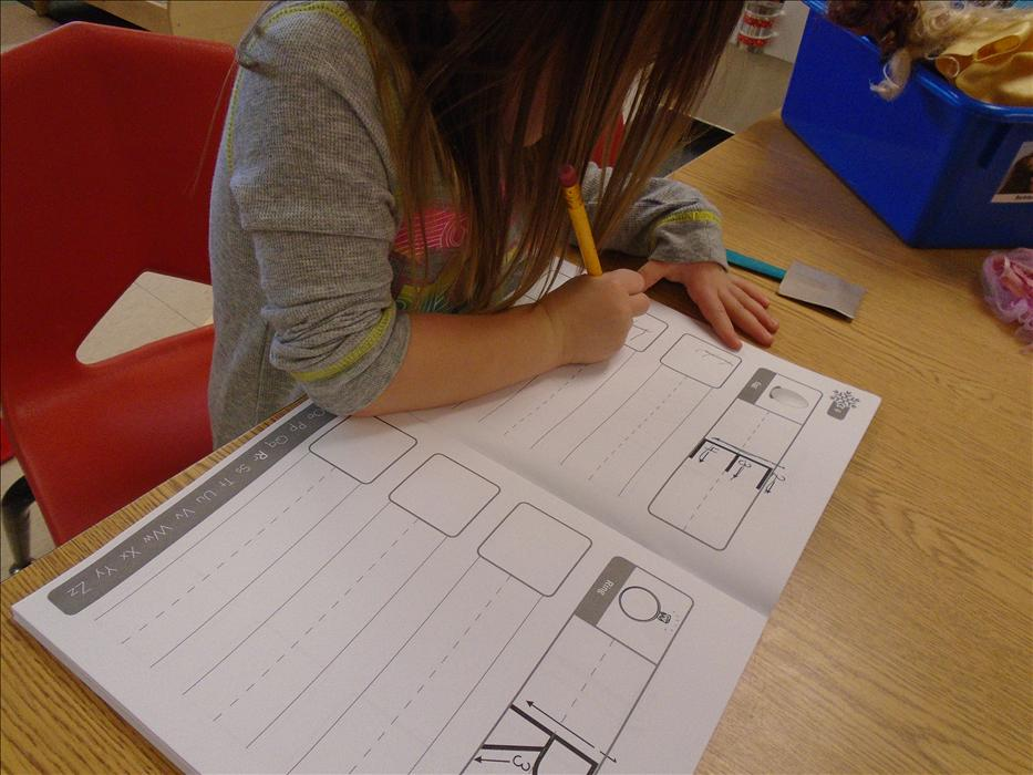 Children practice their writing skills through use of journal entries.