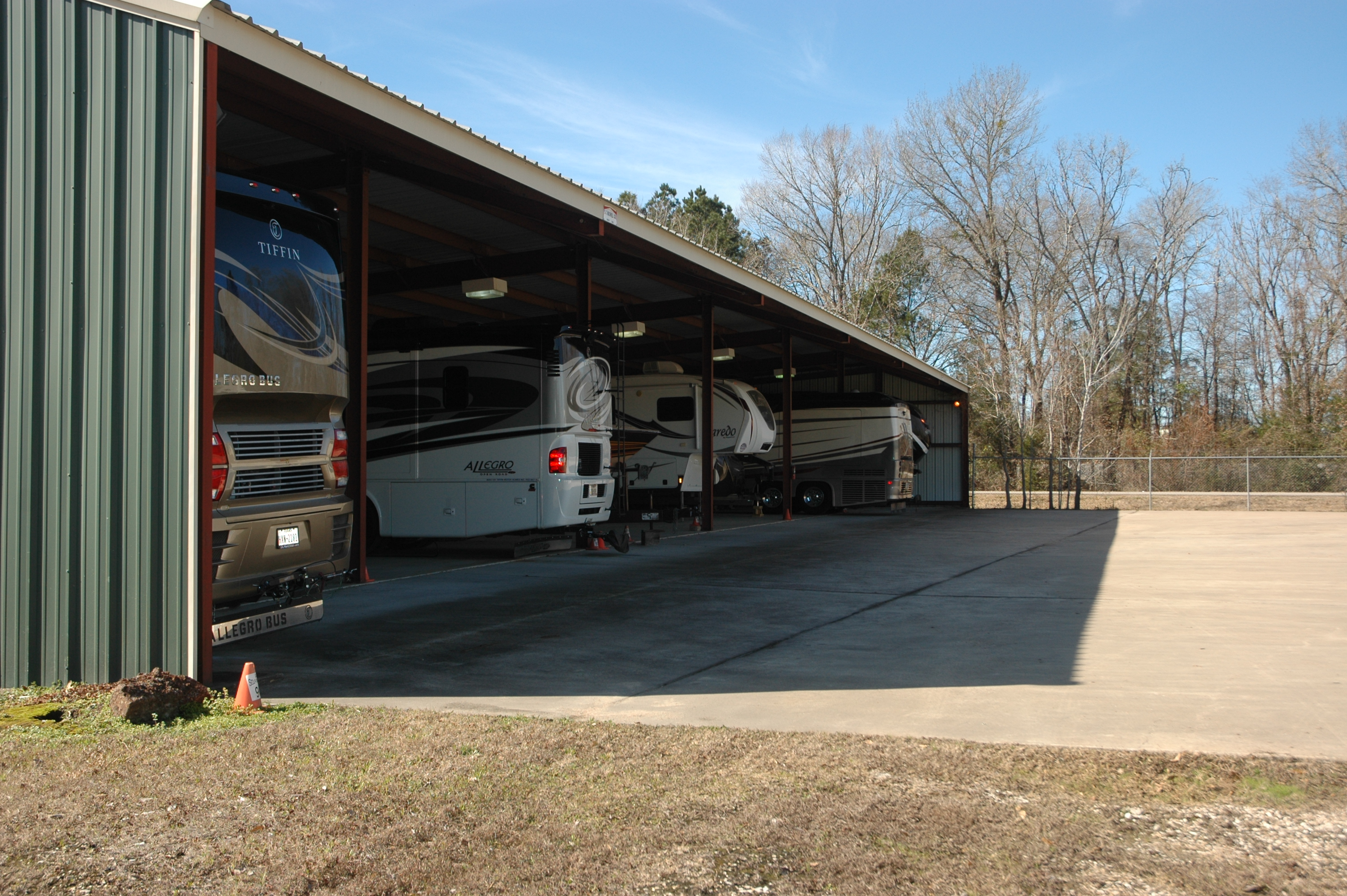 Covered recreational vehicle parking.