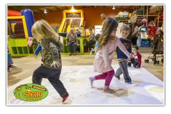 Young children love to play with video interactives games at Safari Adventure Long Island NY