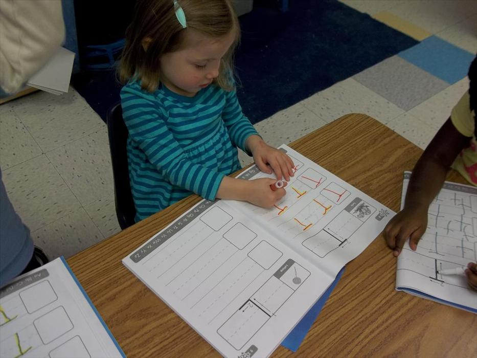 Practicing fine motor skills and letter recognition on our Preschool Classroom