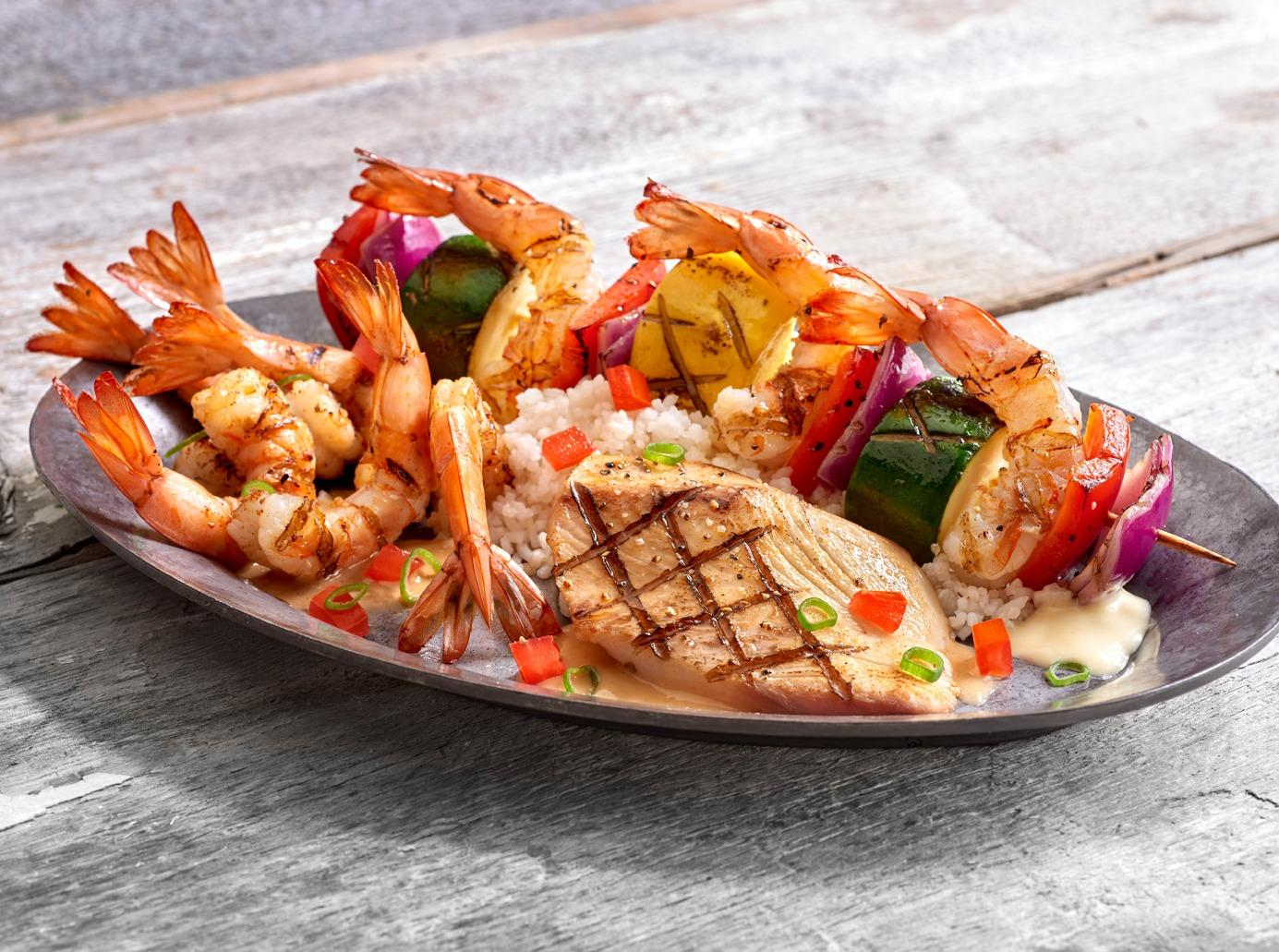 A trio of our most popular grilled seafood... Shrimp & Veggie Skewer, Shrimp New Orleans and our Bourbon Street Mahi Mahi.