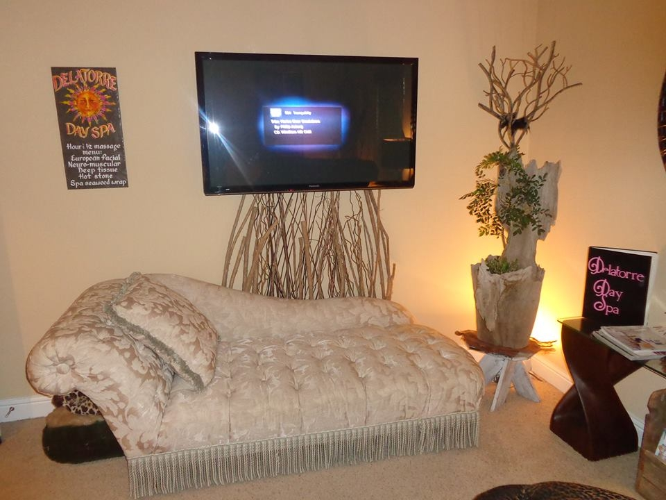Large big screen TV with one on the 2 comfortable loungers for clients to relax and enjoy