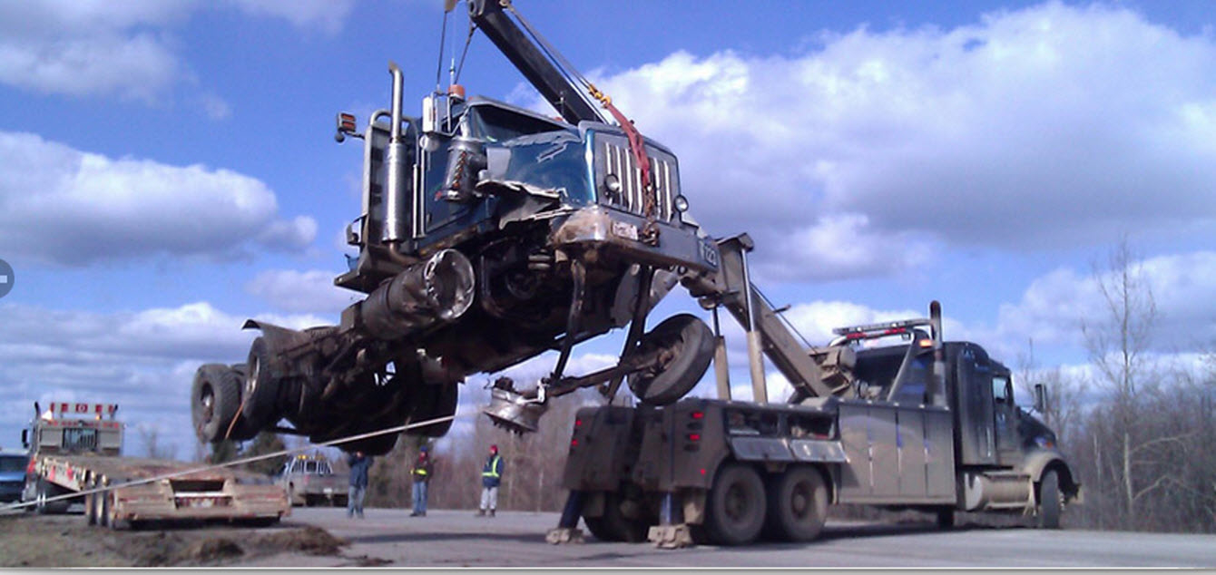 A-1 Equipment Hauling & Towing in Fort McMurray: Trained Personnel for Heavy Equipment Recovery