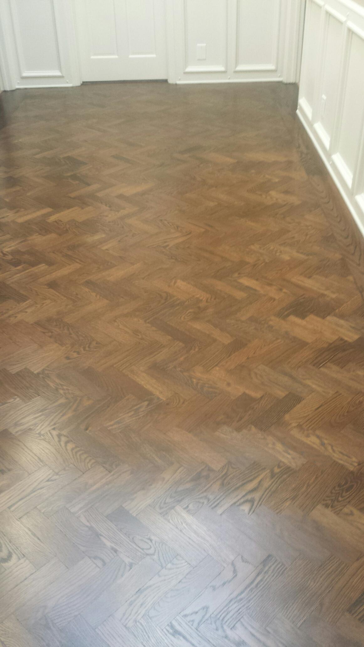 Herringbone flooring sanded and stain with antique brown color and finish with 4 coats of semi gloss polyurethane.