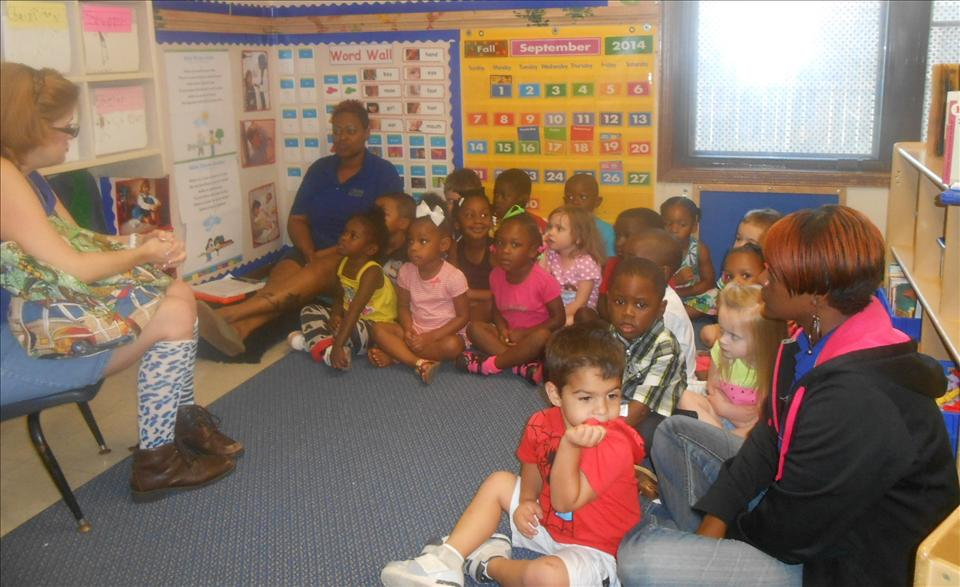 This is What Learning Looks Like: Communicating with others during story-time with Ms. Lisa the local story-teller gives exposure to new vocabulary.