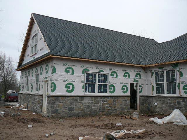 Inspecting exterior vapor sheeting stone facade,exterior windows and doors