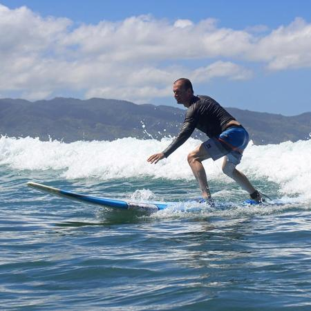 Momentum Bay's founder Mark Alan Robinson, MBA, LEED AP, CEM surfing some small waves again.  Thanks, Uncle Bryan!