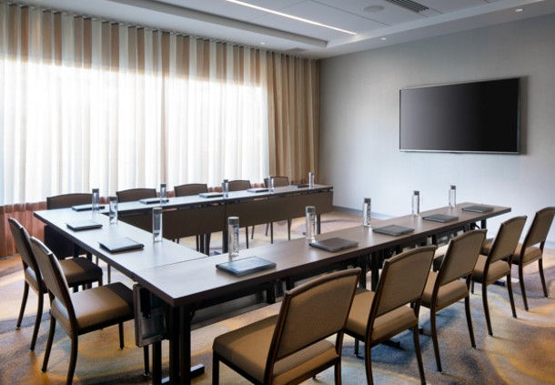 Our tastefully appointed meeting room features flexible seating, Wi-Fi access, a flat-panel TV and catering.