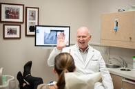 Dr. Greg Campbell congratulating his cavity free patient.
