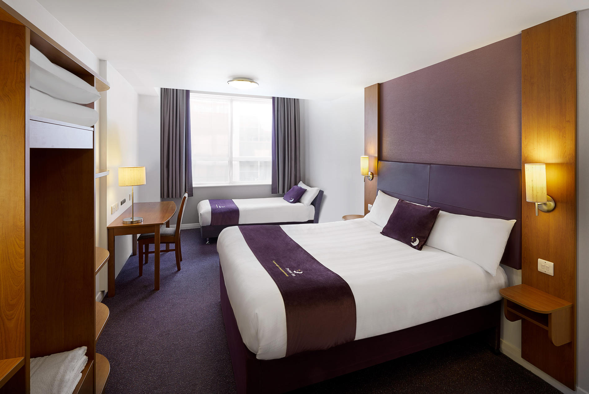 Premier Inn twin room with double bed and single sofa bed
