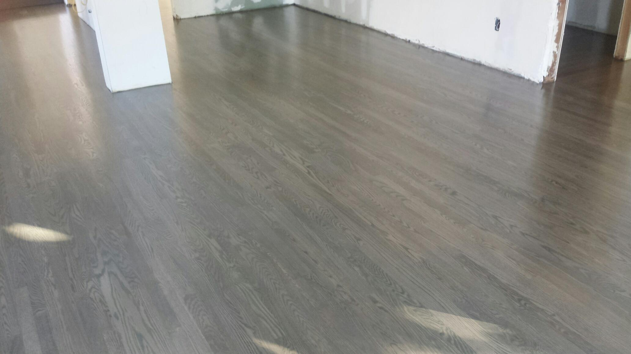Oak Flooring sanded and stain with grey color and finish with 4 coats of satin polyurethane.