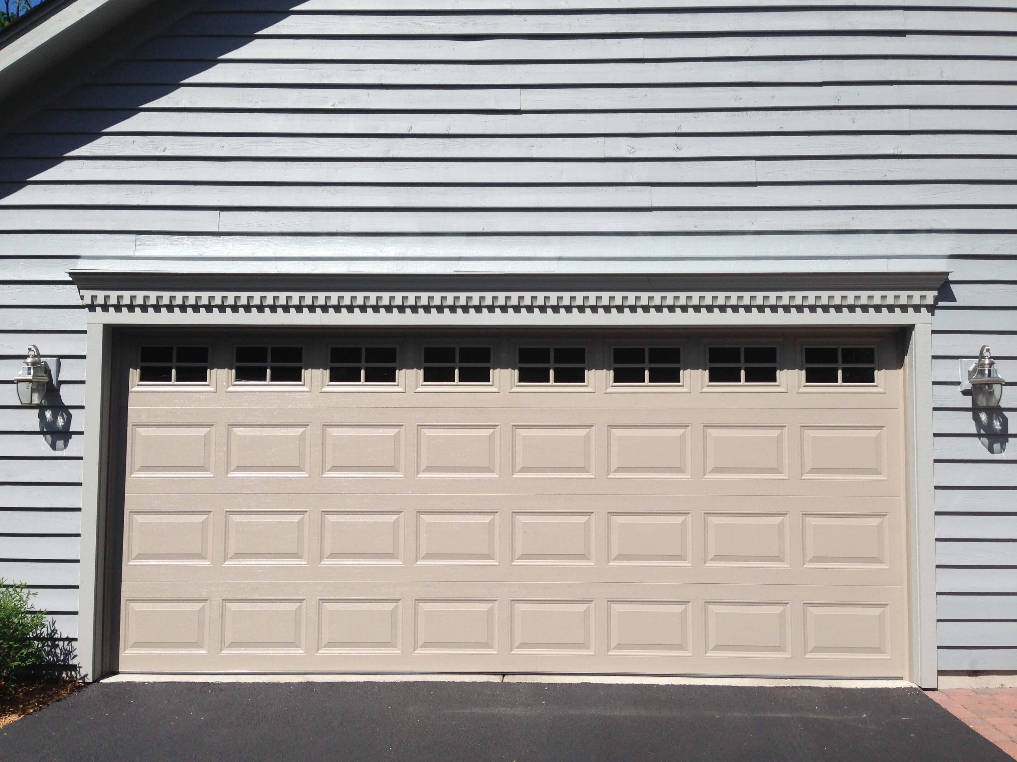 Next door inc in elgin il 847 429 4 for Garage door repair elgin il
