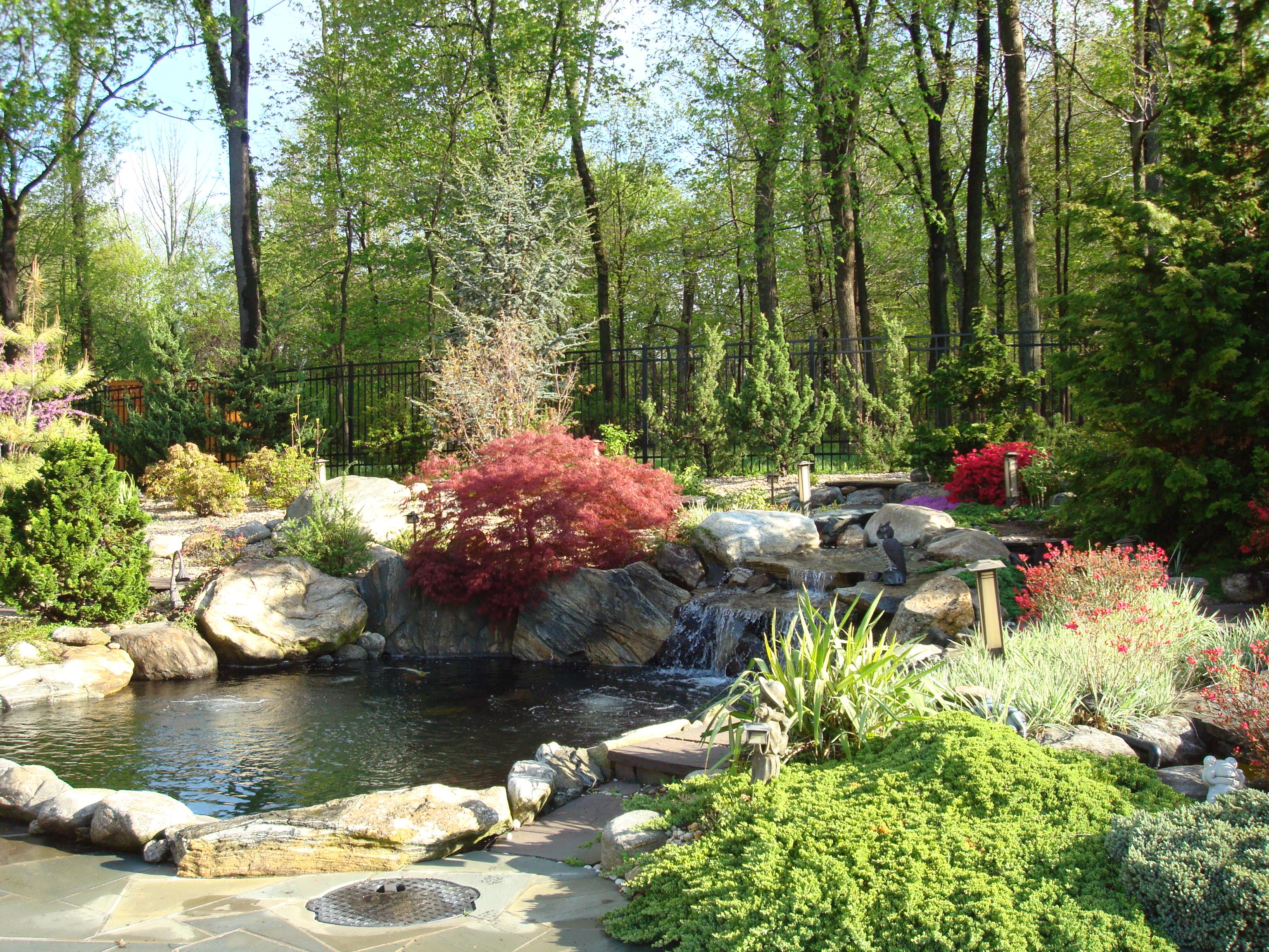 Hand pruned and illuminated plantings are a great joy for the homeowners from one season to another. The expanded landscaping design embraced the traditional Koi ponds that were already in use. We als