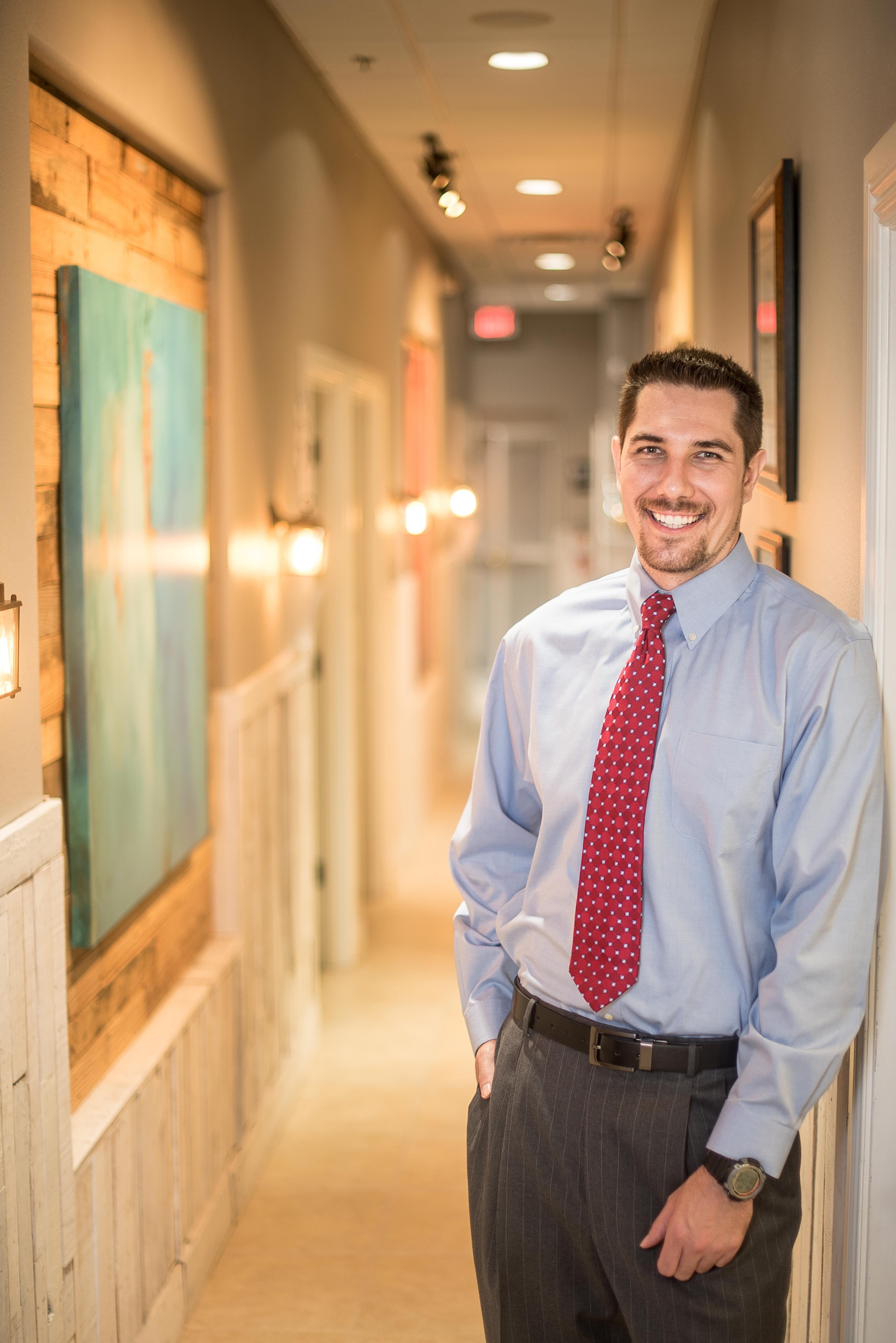 Dr. Brad Bartel near the entrance of Lakeland's Advanced Spinal Care Chiropractic Medspa