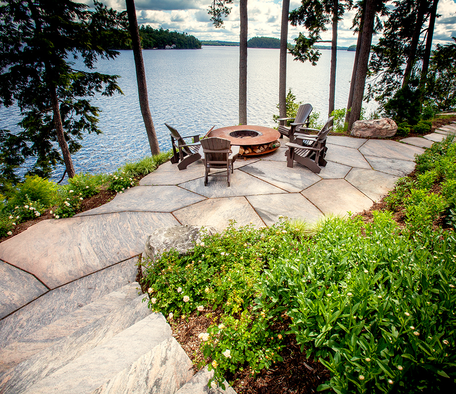 HLD Muskoka in Huntsville: Image of a lake-side fire-pit area built by HLD Muskoka, one of the premier, full-service custom home and cottage builders in Muskoka.
