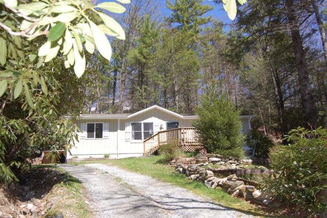 Cute 2 bedroom/2 bath on 1/2 acre wooded lot in Linville Land Harbor.  For more information on this or any of our listings call us at 800-521-3712 or visit our website:  www.northcarolinaland.com.