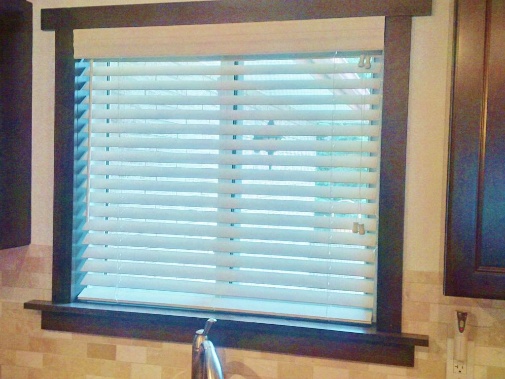 """Budget Blinds à Waterloo: 2"""" Faux Wood Blinds are a relatively inexpensive custom window covering option. Faux wood blinds are moisture resistant and are available in a variety of finishes to suit nearly any decor."""