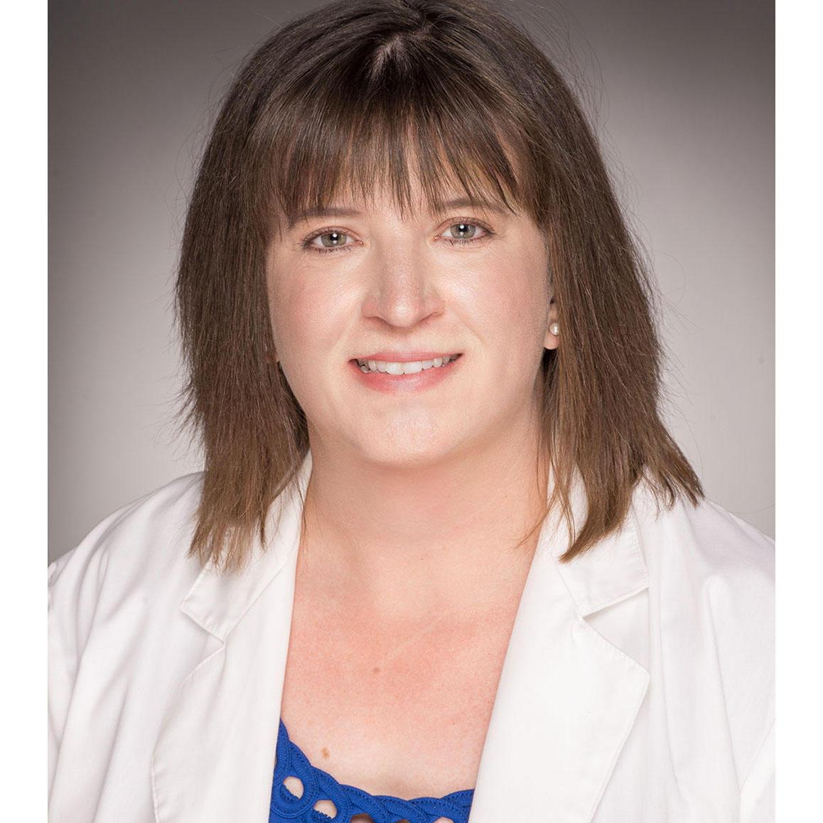 Headshot of M. Kathleen Powderly