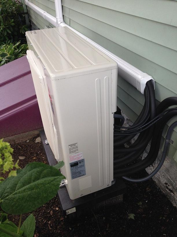 Mitsubishi mini split with one central outdoor unit, & four indoor units. Ultra quiet & efficient.