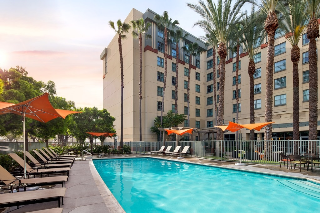 Outdoor Pool - Experience Southern California's perfect year-round weather at our outdoor pool. Splash around with the kids or simply lounge on our deck while soaking up the sun.