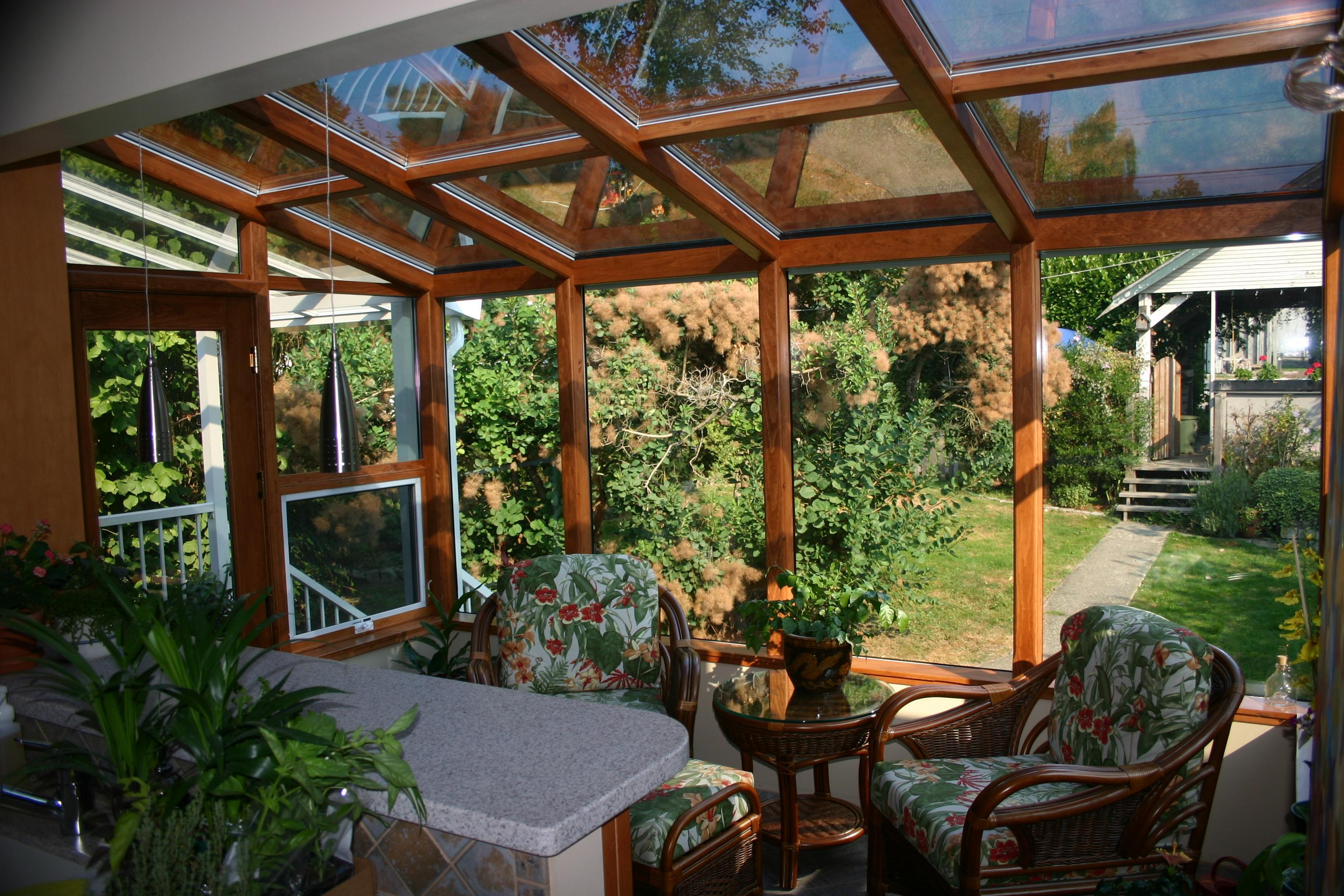 Four Seasons Sunrooms in Port Coquitlam: This sunroom adds a sitting area off the kitchen where space was limited