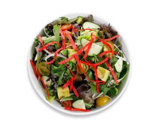 Bowl of the avocado greens salad made by P.ZA Kitchen.