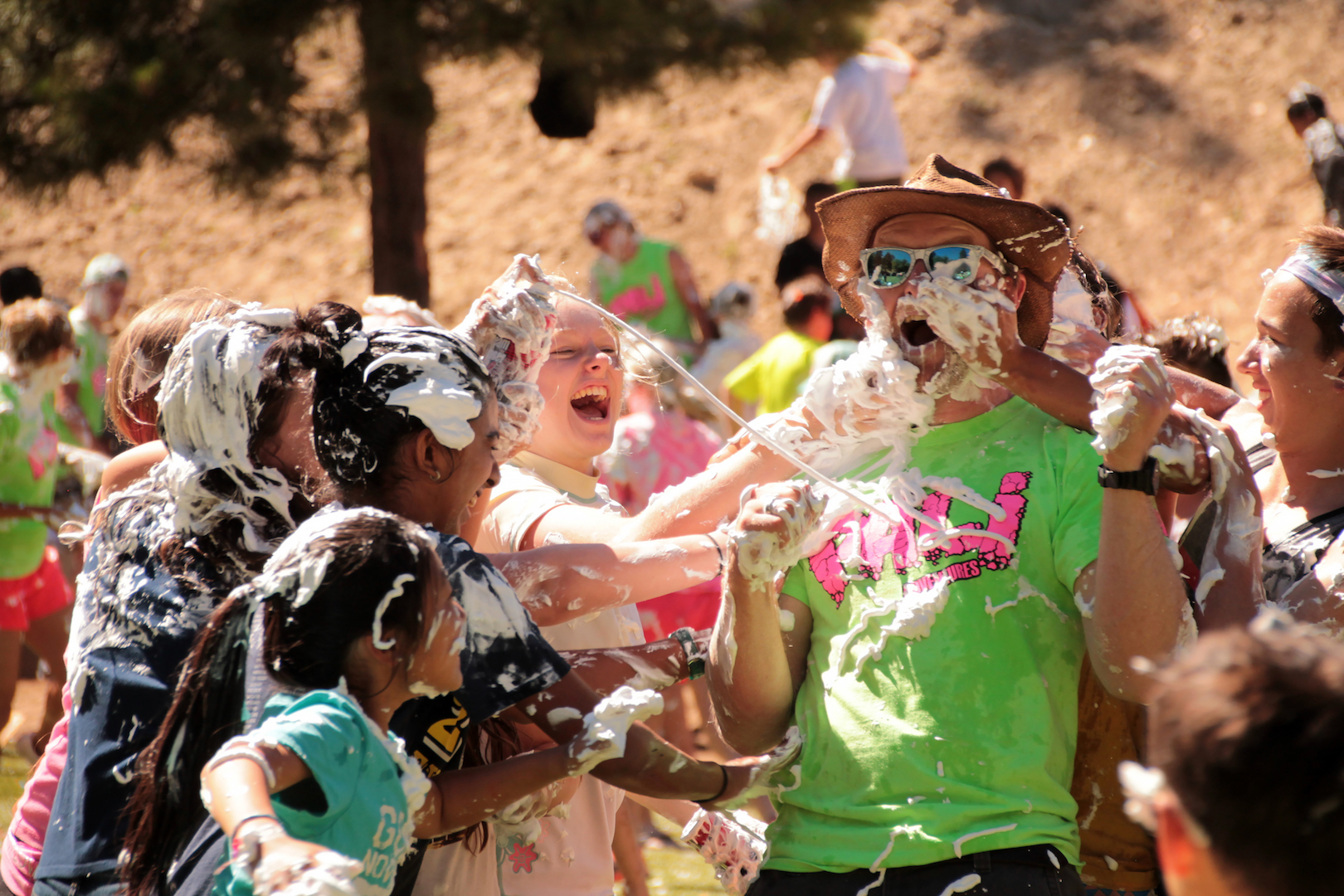 Kids having fun with the camp director in the water war at Pali Adventures Summer Camp