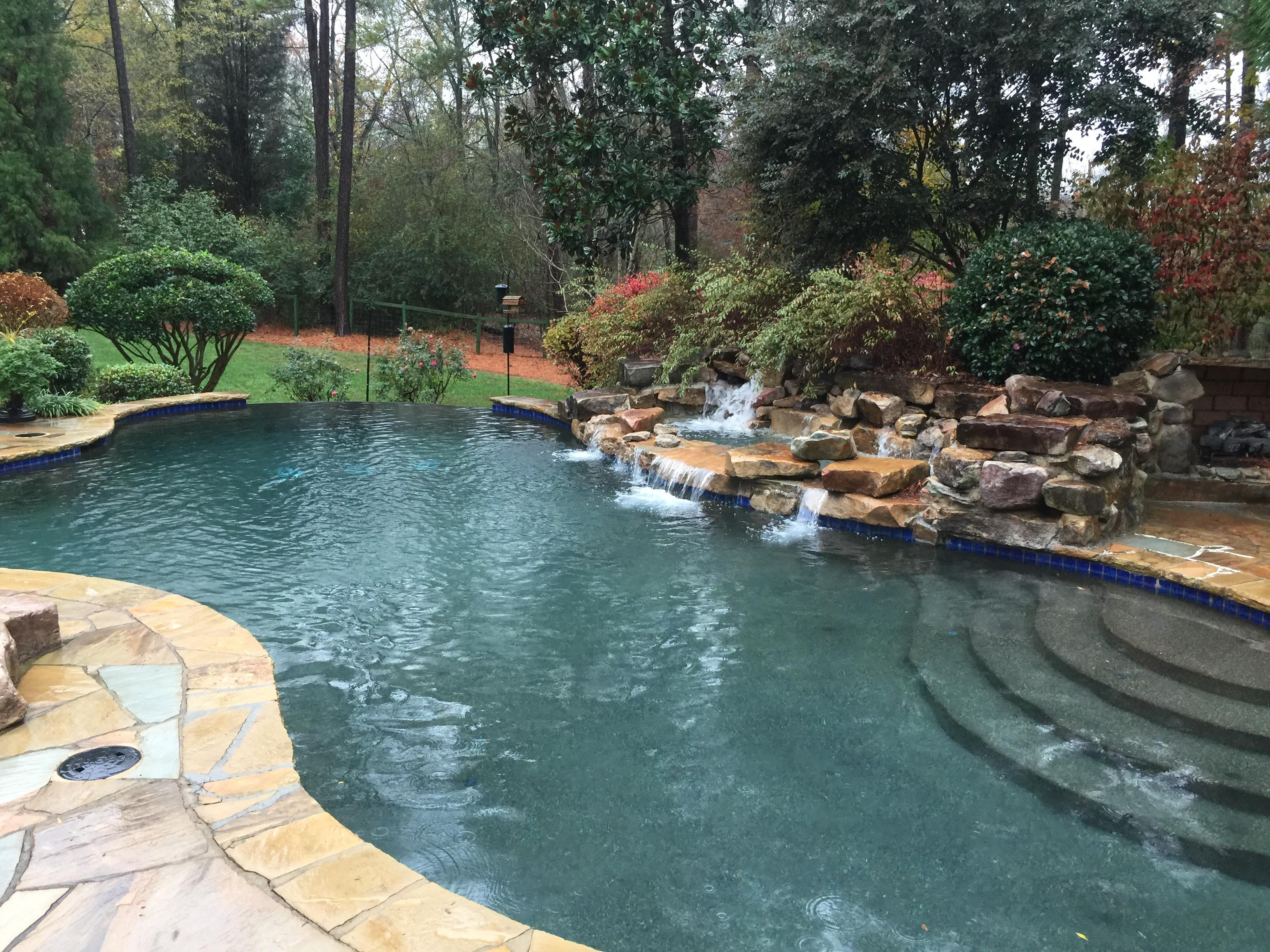 Water fall pool inspected by the best home and pool inspector.