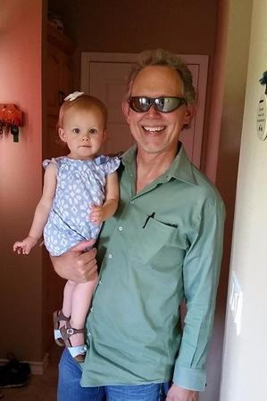 Dr. Fitch, Optometrist, with one of his granddaughters
