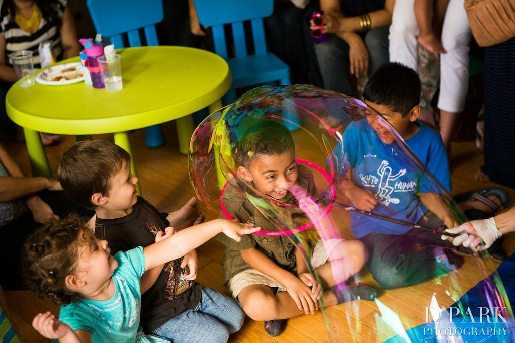 Boy's head in a bubble