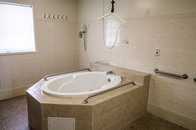 Assistance oriented bathroom with bathtub