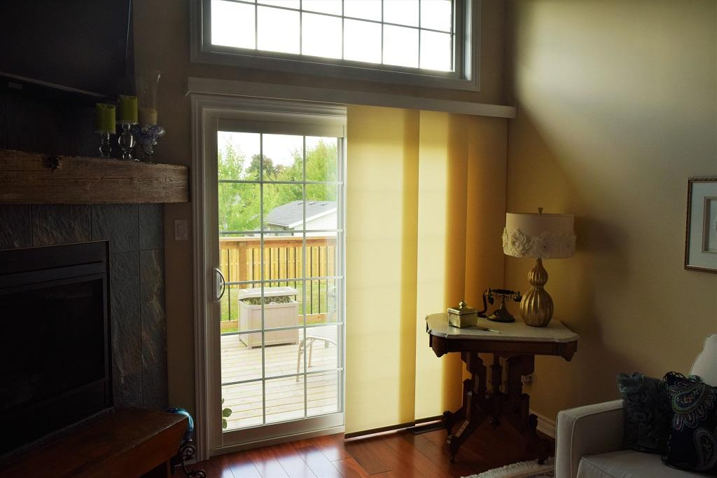 Budget Blinds à Waterloo: This panel track provides some light control and privacy in Stratford. The track is concealed by a custom wood valance.