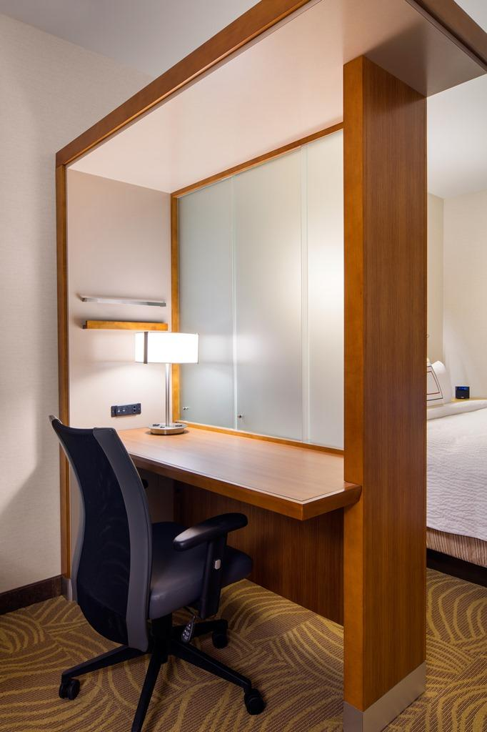 Suite Work Area - If you are traveling to Burbank on business, you will enjoy hotel suites boasting a large work space, complete with convenient lighting, outlets, an ergonomic chair and free Wi-Fi.