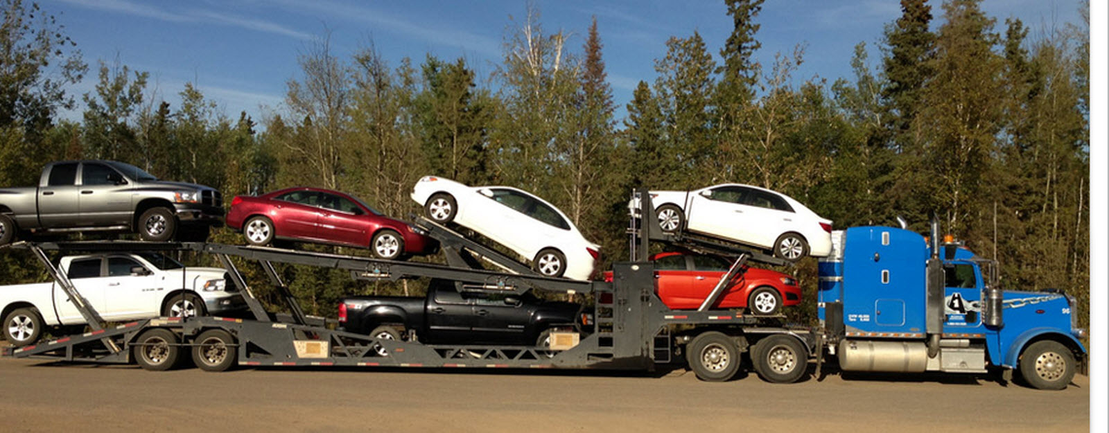 A-1 Equipment Hauling & Towing in Fort McMurray: Car Hauler towing