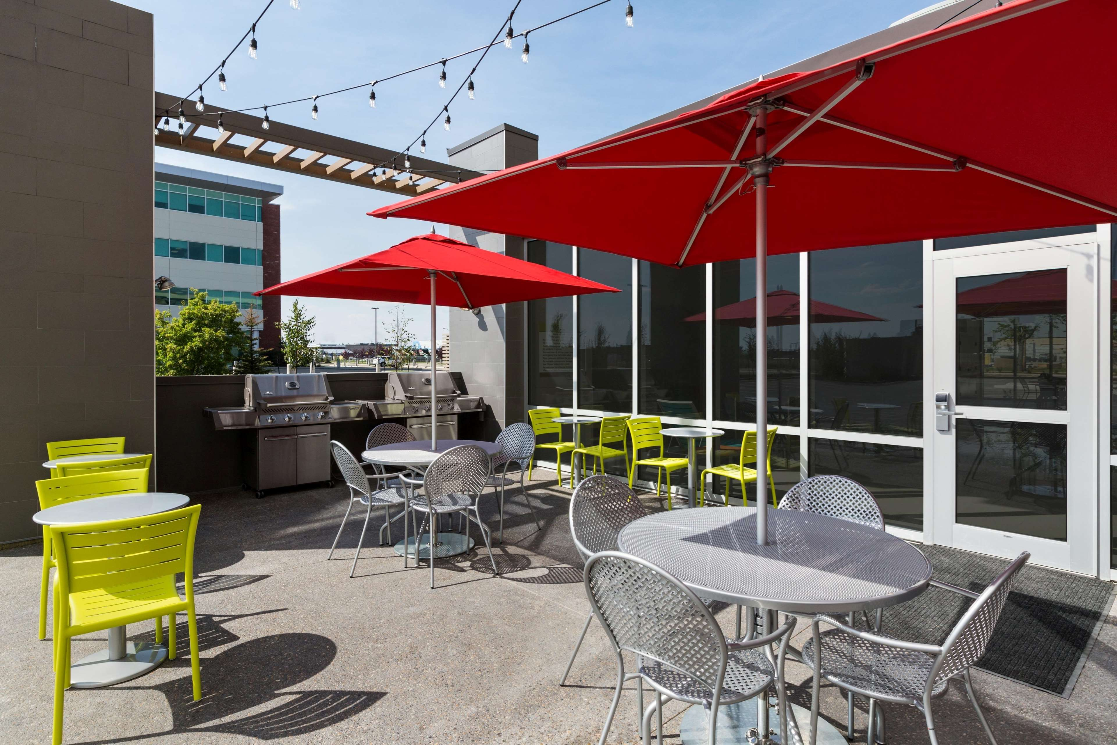 Home2 Suites by Hilton West Edmonton, Alberta, Canada in Edmonton: Patio with BBQ Grill Daytime