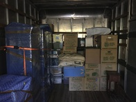 Boxes and furniture stocked in truck during move.