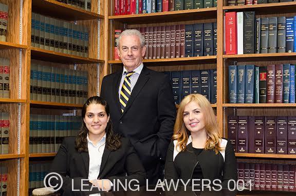 John Moran (Owner), Jawayria Z. Kalimullah (Associate Attorney), and Nerdisa Muratagic (Administrator)