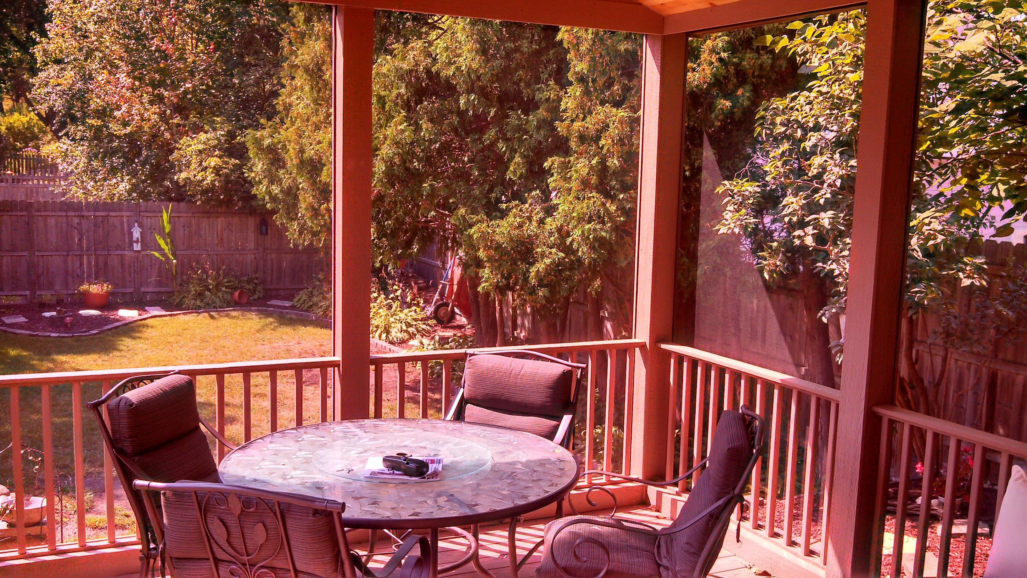 Overlook your back yard while enjoying the relaxing, bug-free fresh air!