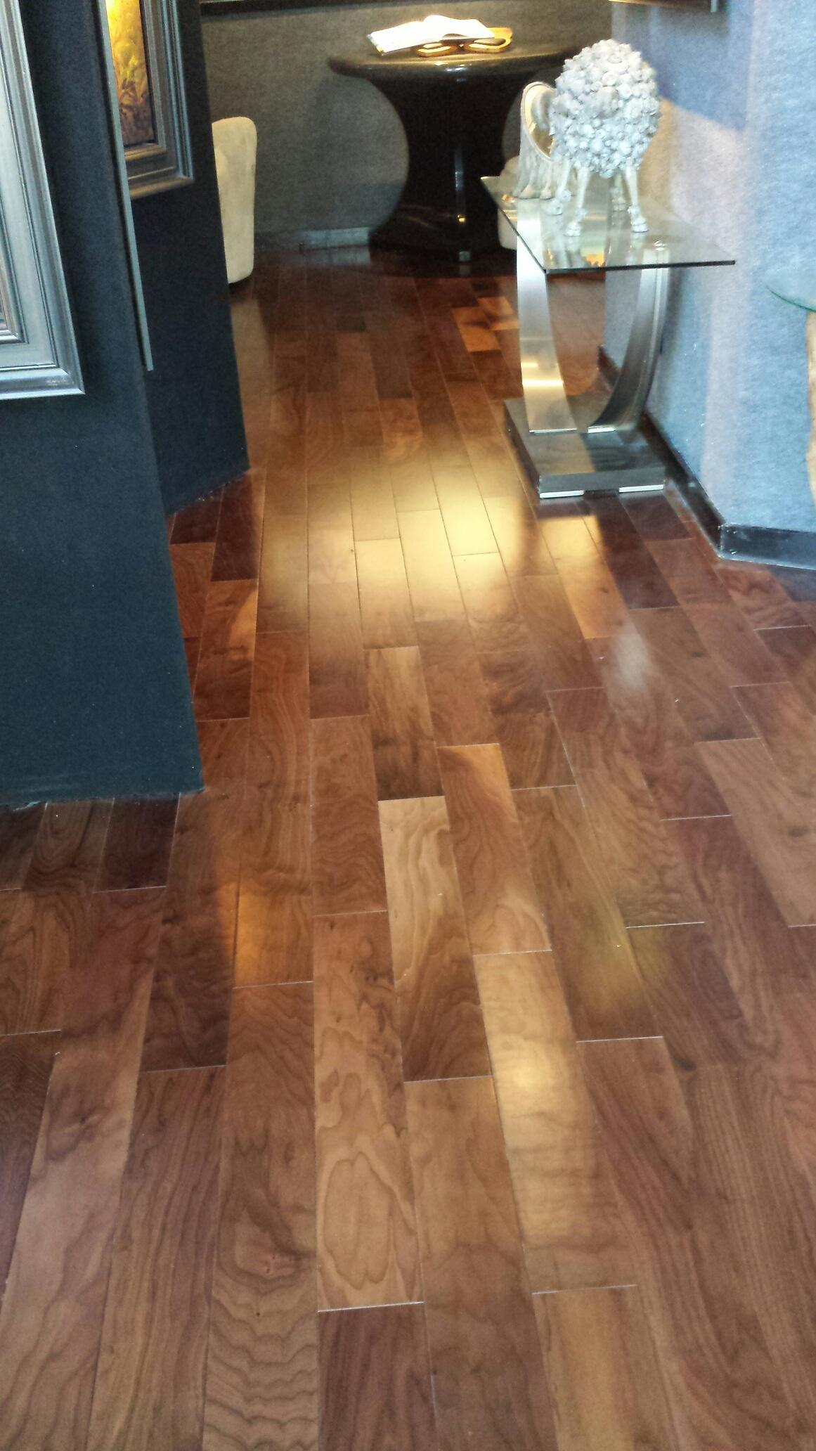 Prefinish floors, engineered mellow brown, color installed in art gallery.