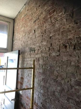 The project cost for tuck pointing your brick wall or chimney by STL Wall & Ceiling may be less than you think. What is tuckpointing? At some point, all brick and mortar structures will need to be repaired. The reason is that mortar- the paste used to bind the brick or stone- becomes damaged over time due to moisture and weather conditions. The process of tuckpointing involves removing the damaged mortar along joints and replacing it with fresh mortar. Tuckpointing is not only needed to improve the curb appeal of a structure but it is also required to ensure the safety and integrity of your St Louis commercial building.