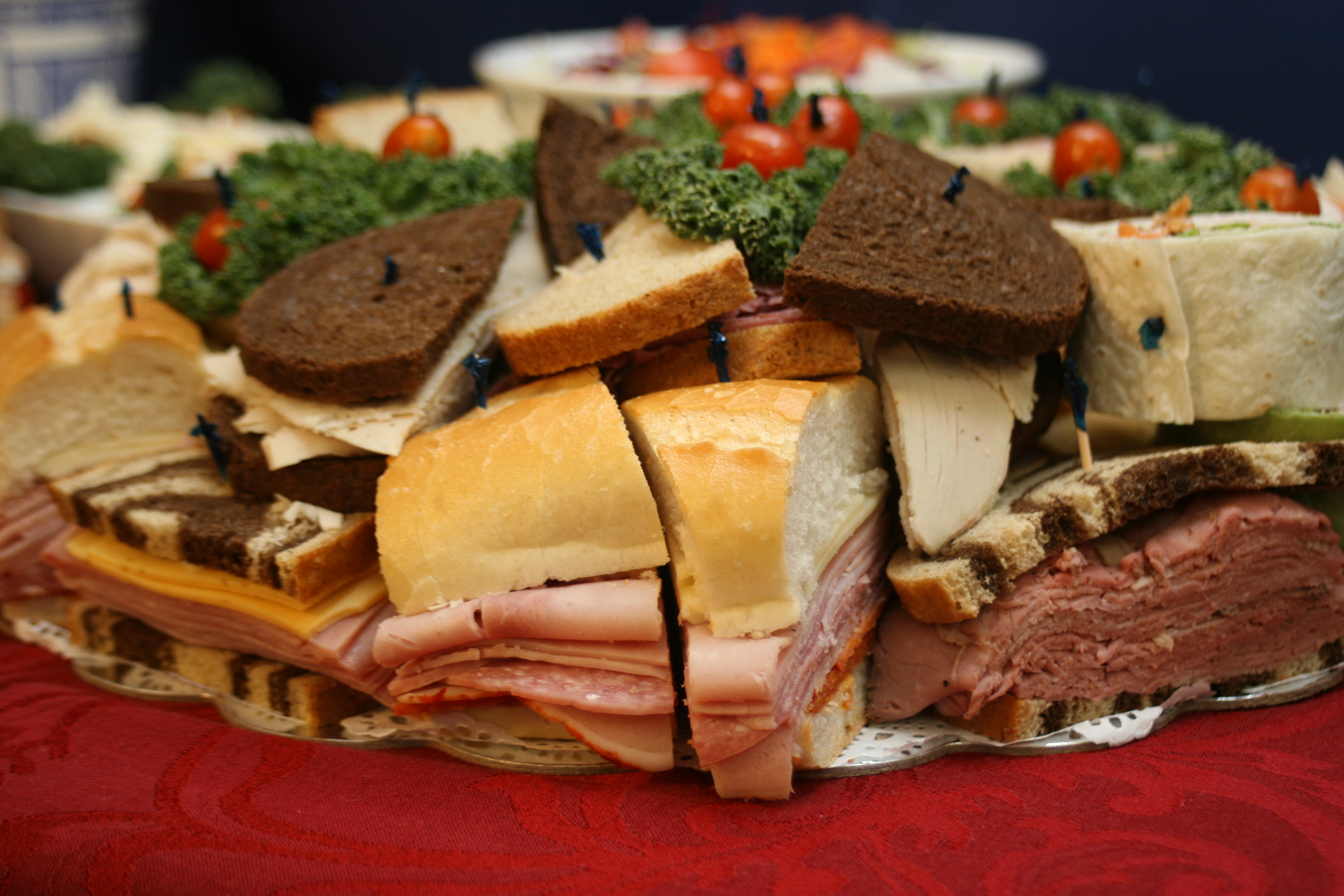 Gourmet Sandwich Platters loaded with tasty wraps, mini heros and sandwichs
