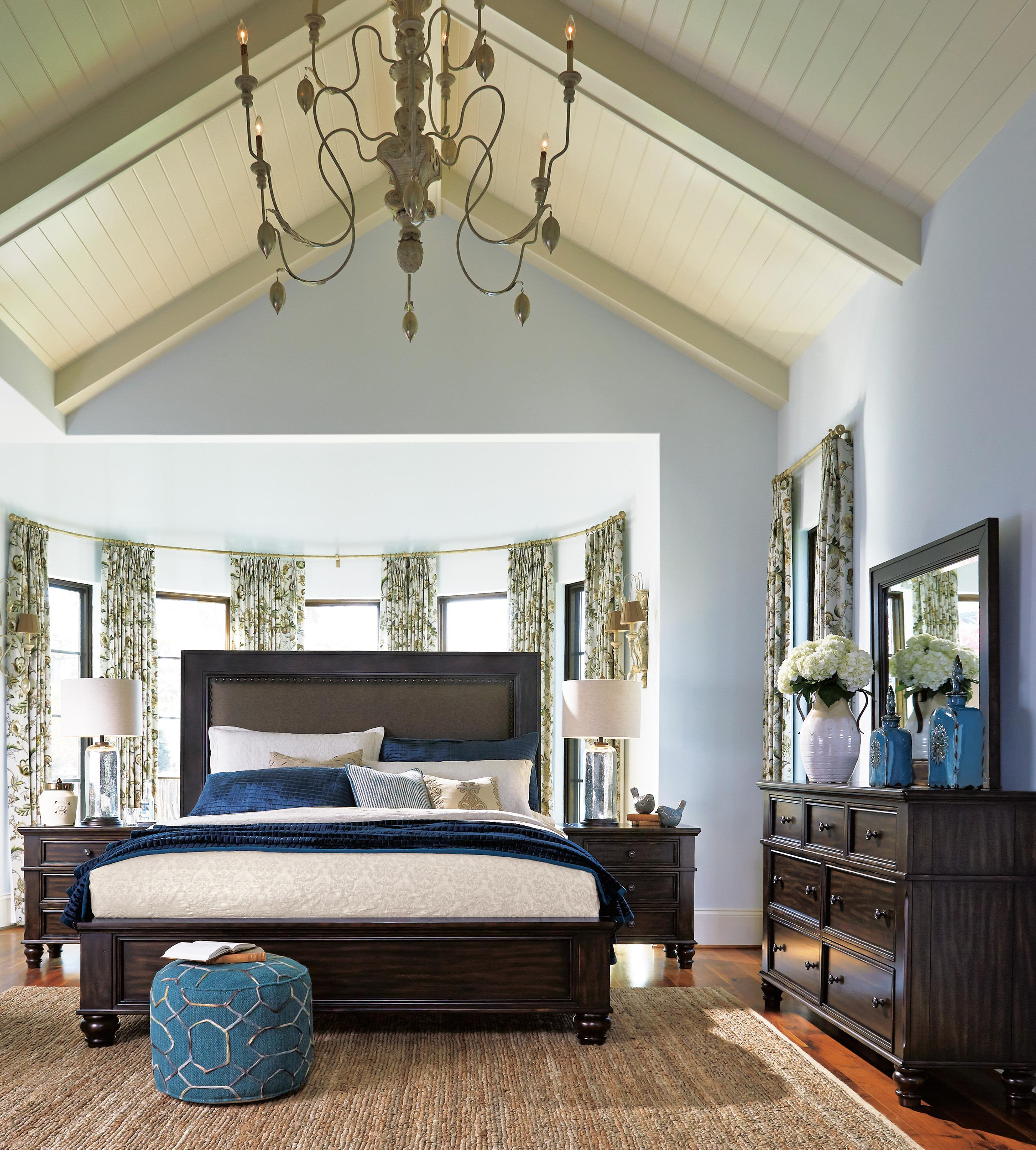 Roddinton queen panel bed frames your sleeping haven like a work of art. Soaring headboard is comfortably cushioned, upholstered in a textured twill and serenaded with classic nailhead trim. Low paneled footboard makes it easy to sit at the foot of the bed and dress for the day.
